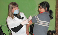 Nurse vaccinating a young woman